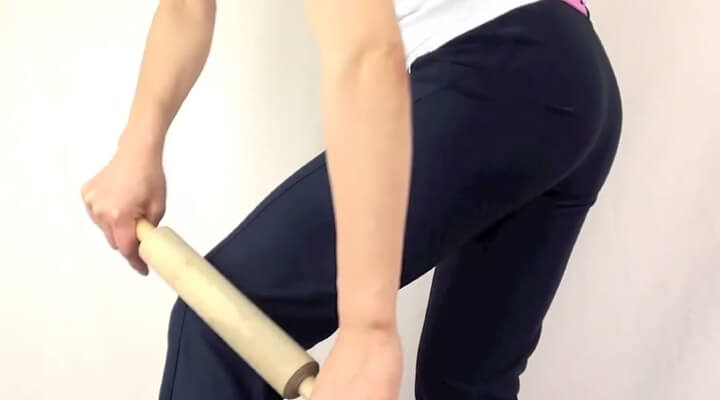 Photo showing a person's leg while they've been massaged with a rolling pin.