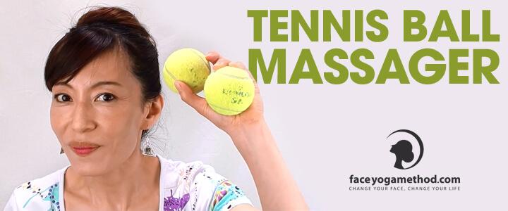 Fumiko Takatsu holding twi tennis balls in her lifted left hand.