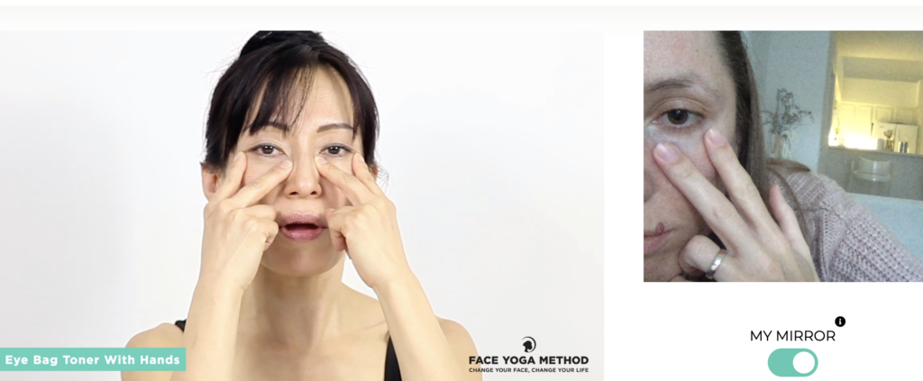Two women practicing facial exercises.