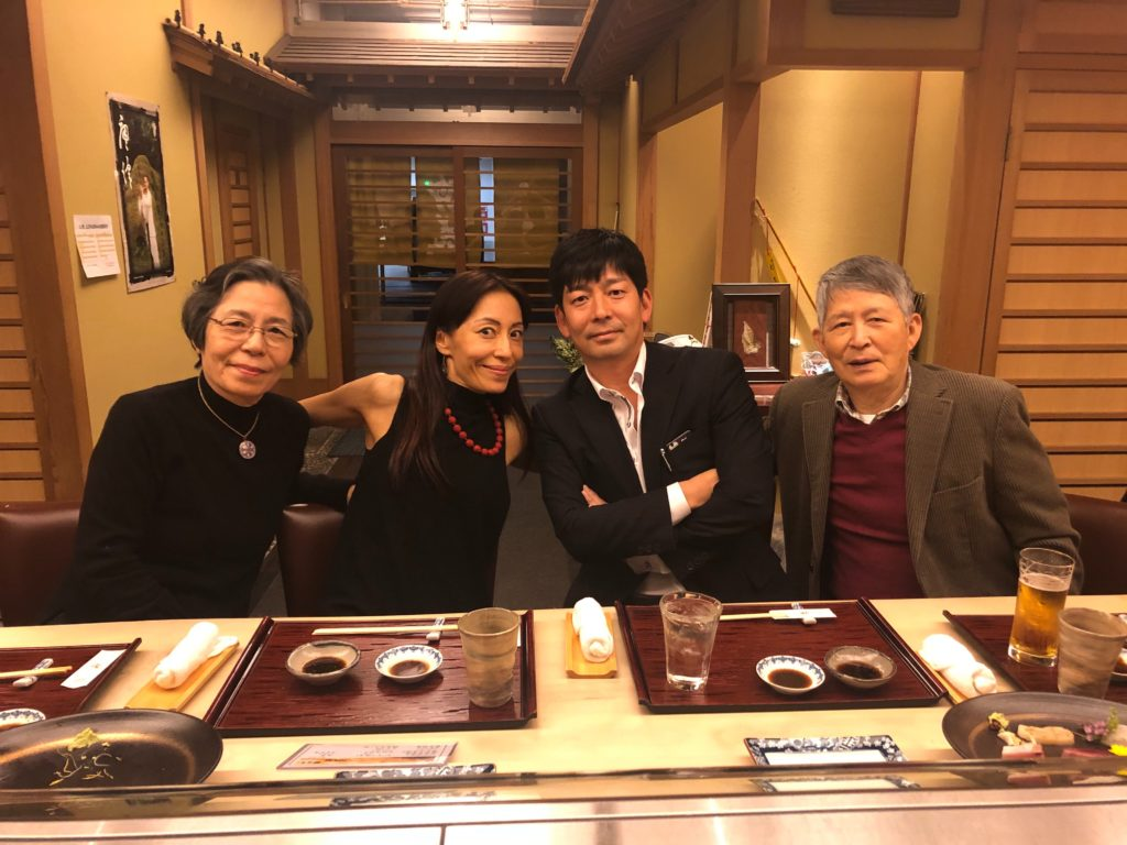 A family of four in a Japanese restaurant.